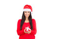 Woman gift wearing a santa hat holding a red with copy space Stock Photography
