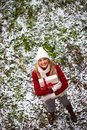 Woman with giftbox image of smiling girl standing on snow covered grass outside Stock Photography