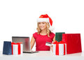 Woman with gifts laptop computer and credit card christmas x mas online shopping concept in santa helper hat gift boxes bags Stock Photography