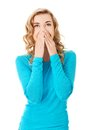 Woman giggles covering her mouth with hand Stock Photography
