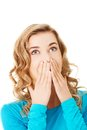 Woman giggles covering her mouth with hand Royalty Free Stock Photos