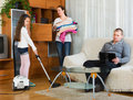 Woman and girl doing cleaning Royalty Free Stock Photo