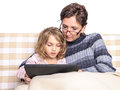 Woman and girl doing homework on tablet pc Royalty Free Stock Photo