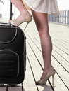 Woman girl foot sea mooring suitcase on a pier Royalty Free Stock Photography