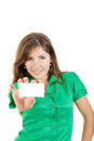 Woman or girl in green shirt with bussiness card against white b pretty smiling young background copy space for text and marketing Royalty Free Stock Photo