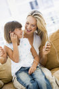 Woman and girl in living room with MP3 player Royalty Free Stock Photography