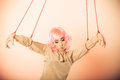Woman girl stylized like marionette puppet on string young Royalty Free Stock Image