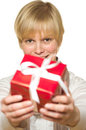 Woman gives gift Stock Images