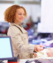 Woman giving credit card  to cashier Royalty Free Stock Images
