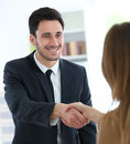 Woman giving handshake to financial advisor Royalty Free Stock Photo