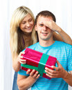 Woman giving a present to her boyfriend Stock Photos