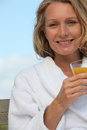 Woman with glass of juice Royalty Free Stock Photos