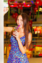 Woman with a glass of juice portrait beautiful young in shopping center Royalty Free Stock Photography