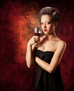 Woman with glass of red wine on grunge background Royalty Free Stock Photo