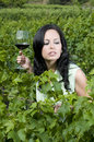 Woman with glass red wine in a Vineyard Stock Photo