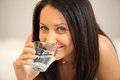 Woman with glass of water drinking from Stock Images