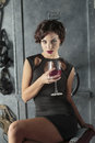 Woman with glass of wine Stock Photo