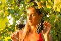 Woman with glass of wine in vineyard the sunshine she is the queen Stock Photography