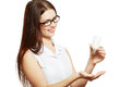 Woman in glasses holding lamp beautiful young energy saving bulb Stock Photo