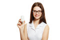 Woman in glasses holding lamp beautiful young energy saving bulb Stock Image