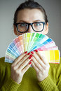 Woman in a glasses looking to a color paint palette fashion concept Royalty Free Stock Image