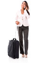 Woman going on a business trip and talking the phone isolated over white Royalty Free Stock Image