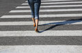 Woman going on the crosswalk young Royalty Free Stock Photography
