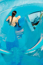 Woman going down a water slide Royalty Free Stock Photo