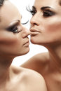 Woman going to kiss her girlfriend attractive women Royalty Free Stock Photography