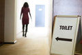 Woman going to toilet public Stock Images