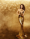 Woman Gold Dress, Fashion Model, Champagne in Long Golden Gown Royalty Free Stock Photo