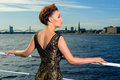 Woman in golden dress on the yacht in riga Royalty Free Stock Image