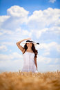 Woman in golden field Stock Photography