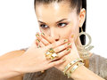 Woman with golden nails and beautiful gold jewelry Stock Photo