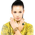 Woman with golden nails and precious stone emerald Royalty Free Stock Photo