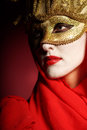 Woman in golden party mask closeup portrait of sexy theater for desire concept Stock Image