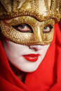 Woman in golden party mask closeup portrait of sexy theater for desire concept Stock Photo
