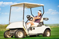 Woman in golf cart young attractive driving Royalty Free Stock Images