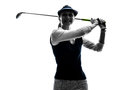 Woman golfer golfing silhouette in white background Royalty Free Stock Photos