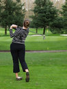 Woman golfer swing Stock Photography