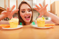 Woman grabbing delicious sweet cake gluttony with cream and fruits on top appetite and concept Royalty Free Stock Photos