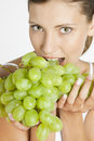 Woman with grape Royalty Free Stock Image