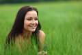 Woman on grass in green fields Royalty Free Stock Photo