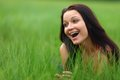Woman on grass in green fields Stock Image
