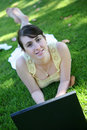 Woman on grass with laptop Stock Photos