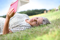 Woman in grass reading a book Royalty Free Stock Photo