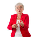 Woman with gray hair stock photo businesswoman and a red blazer isolated on white Royalty Free Stock Photography