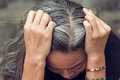 Woman and gray hair with worried stressed face looking down Royalty Free Stock Photo