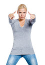 Woman gray sweater gesturing guns her hands isolated white Royalty Free Stock Photography