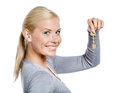 Woman gray sweater keeps key isolated white Stock Photos
